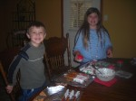 Andrew and Abigail dipping pretzels